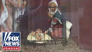Diamond and Silk on caged baby Jesus nativity scene
