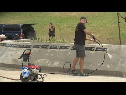 Law enforcement officers clean Hawaii memorial after vandalism