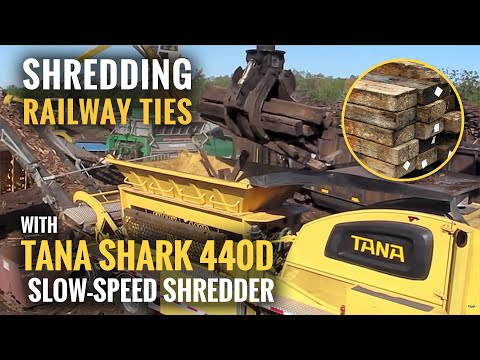 Shredding wooden railroad ties / railway sleepers with TANA Shark waste shredder