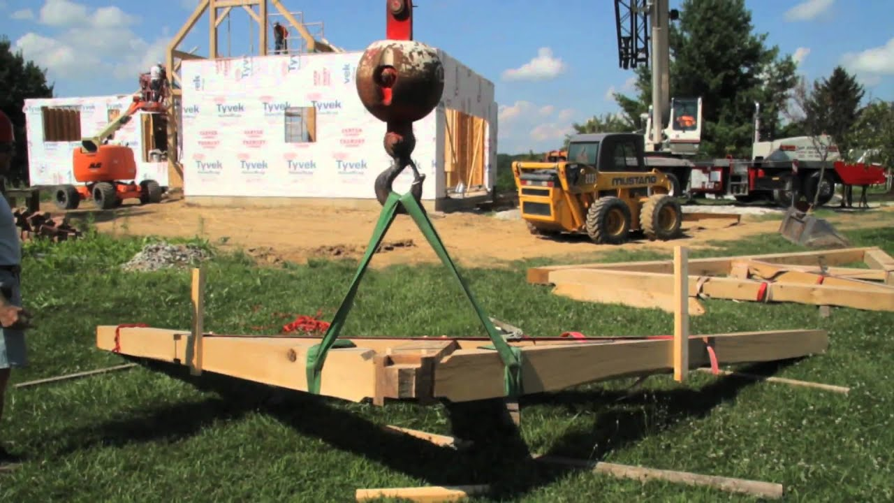 CRANE RAISING AN OAK TIMBER HOME IN ILLINOIS USING THE ENGLISH TYING JOINT