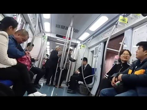 occasional beggars in every line of Beijing Subway system