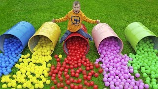 Kids playing with colored barrels and balls by iFinger