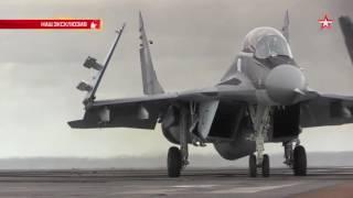 Кадры взлета и посадки самолетов с авианесущего крейсера «Адмирал Кузнецов»(Телеканал «Звезда» публикует кадры взлета и посадки самолетов Су-33 и МиГ-29КУБ с авианесущего крейсера «Адм..., 2016-11-01T11:17:35.000Z)