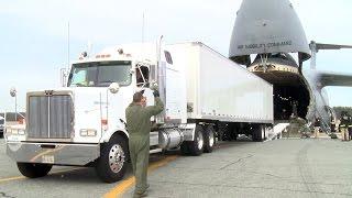 Watch A Gigantic C-5 Galaxy Cargo Aircraft Swallows A Semi Truck