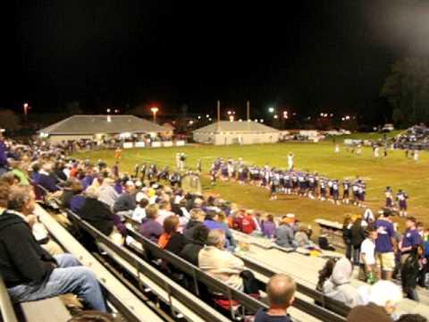 Clown Streaks Across High School Football Field During A