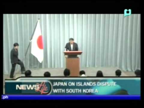 Japan on islands dispute with South Korea; Mrs. Obama meets Families of shooting victims