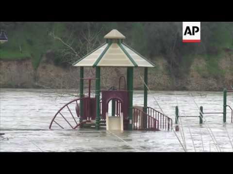 Raw: California Crews Rush to Drain Lake
