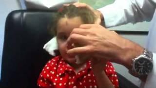 Abigail having her bandage removed Thumbnail