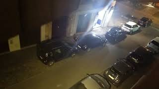 This could be your car! Drunk man pees among the cars parked in the city center
