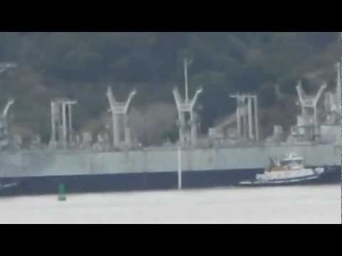 New Nada with mothballed ship USS Roanoke (AOR-7) passing by
