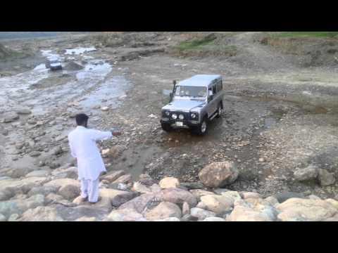 Defender 110 Rock Crawl up dry waterfall