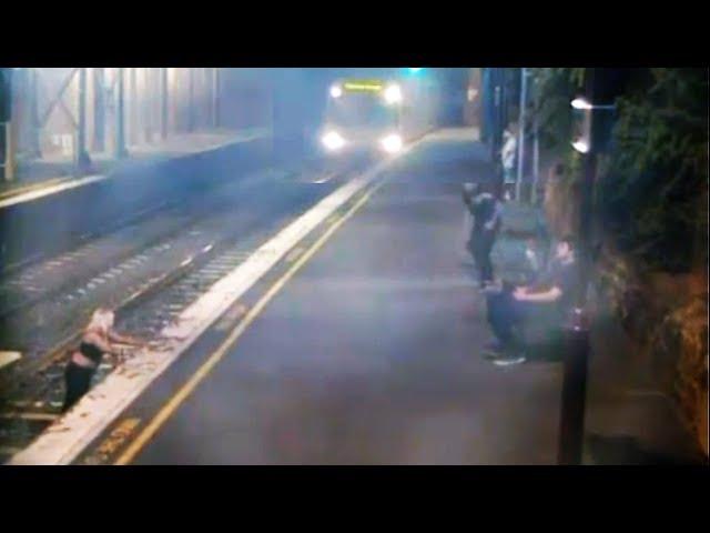 Una mujer ebria se libra por los pelos de ser arrollada por un tren