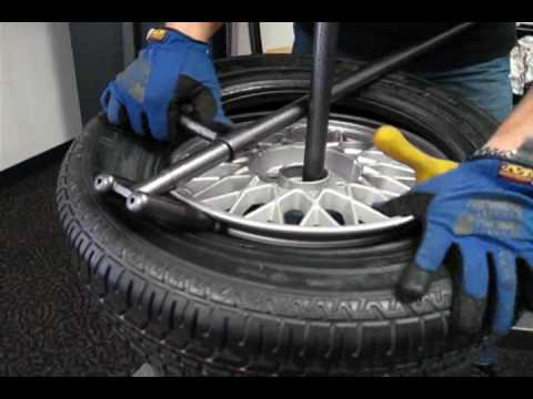 Change A Car Tire On A No Mar Scratch Proof Tire Changer