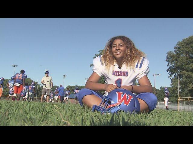 Female Football Player Throws Touchdown Pass