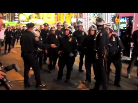 Awesome Marine Takes On 30 Cops In Wallstreet Faceoff 2011 EPIC - YouTube.flv
