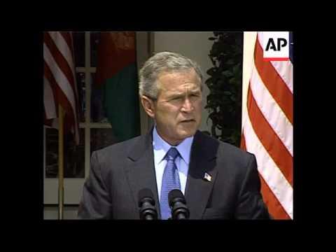 Bush with Karzai, Bush comments on Saddam