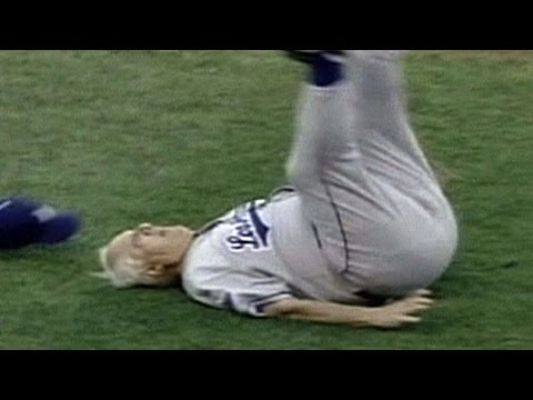 2001 ASG: Lasorda tumbles after being hit...