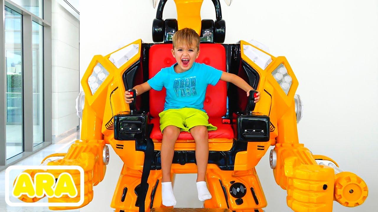 فلاد ونيكي نتظاهر باللعب مع لعبة ركوب السيارات