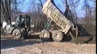 Dump Truck Moxy at Work Dumping River Gravel