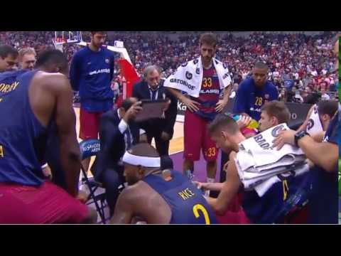 Barcelona coach Bartzokas throws the board during time-out