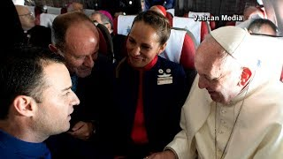 Pope Francis marries couple in first-ever marriage aboard papal plane