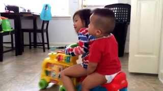 Toddler and baby rides toy train