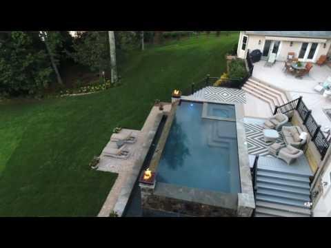 Infinity edge pool by Aqua Design Pools - YouTube