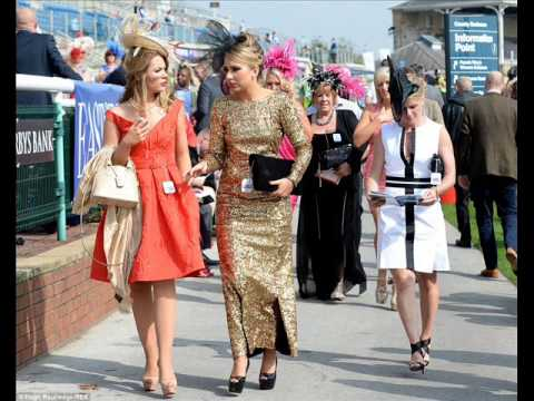 Colourful Headgear And Bold Body Art Take Centre Stage As La Day At Doncaster Gets Under