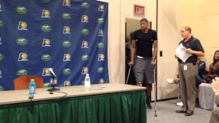 On crutches, Paul George makes his arrival.