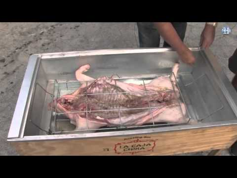 How to roast a whole pig in a Caja China