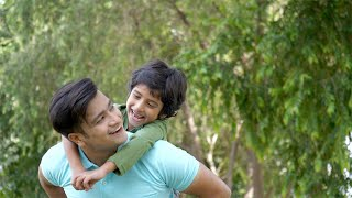 Indian father and son enjoying the weekend while playing in a park - happy family