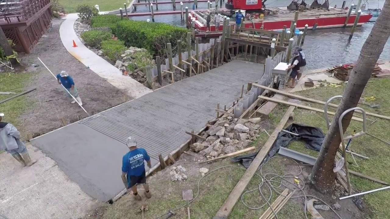 Pouring a concrete boat ramp - YouTube