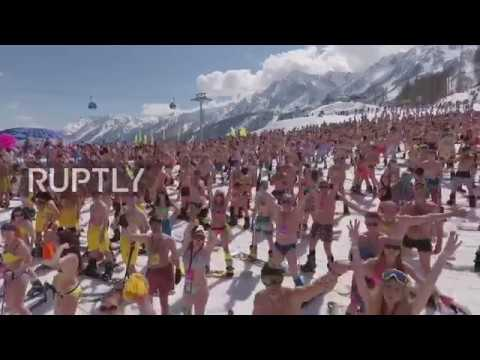 Russia: Scores in swimsuits ski down slopes near Sochi in Guinness record bid