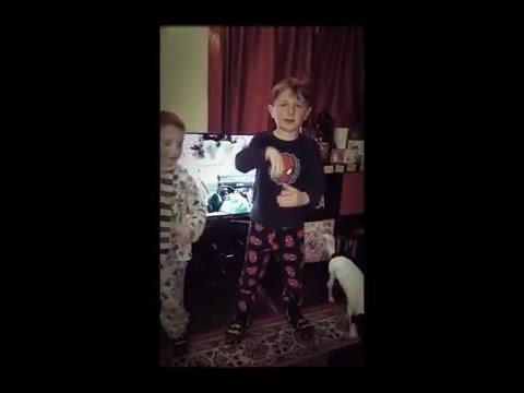 Two brothers singing Santa Koala