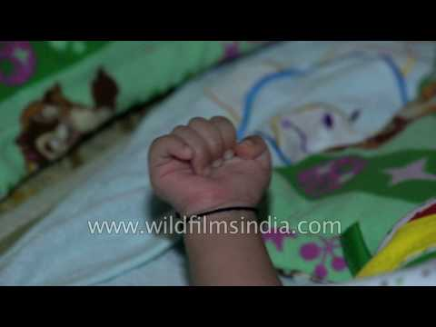 Baby closes her hand into a fist