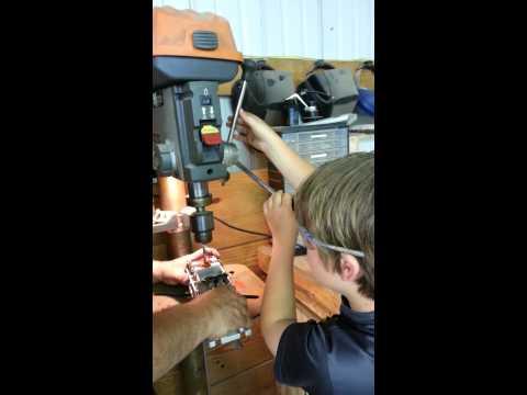Mason drilling a blank
