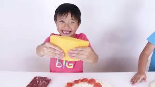 Adam and Austin Home make pizza