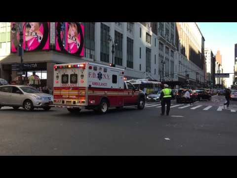 FDNY EMS AMBULANCE RESPONDING ON WEST 34TH STREET IN THE MIDTOWN AREA OF MANHATTAN IN NEW YORK CITY.