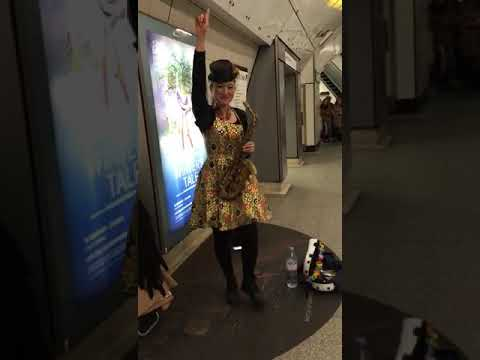 Happy Asian Lady Playing Reggae on her saxophone