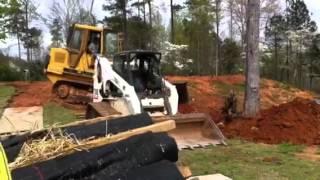 Track Loader removing large tree