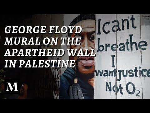 Der palästinensische Künstler Taqi Spateen malt George Floyd an der Trennmauer