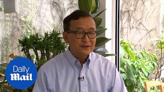 Opposition leader Sam Rainsy denounces Cambodia's 'sham election'