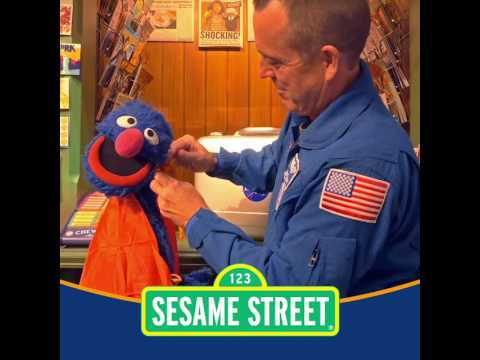 NASA Astronaut Returns Sesame Street Mementos Flown on Orion Spacecraft (Grover's cape)