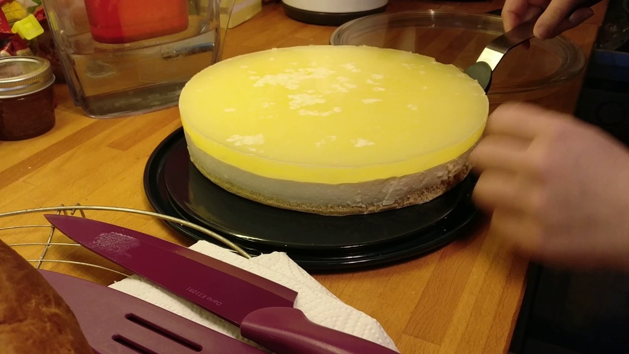 transferring the cake to the cake stand - YouTube