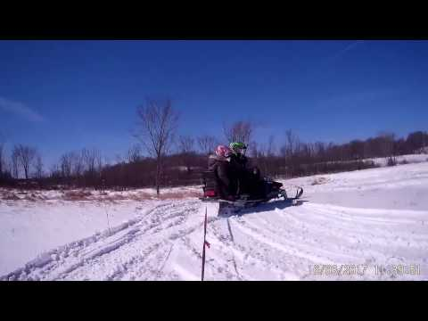 Pulling GT Racer with Snowmobile through a field POV