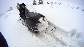 Снегоход Буран в глубоком мокром снегу. Заводим без стартера.