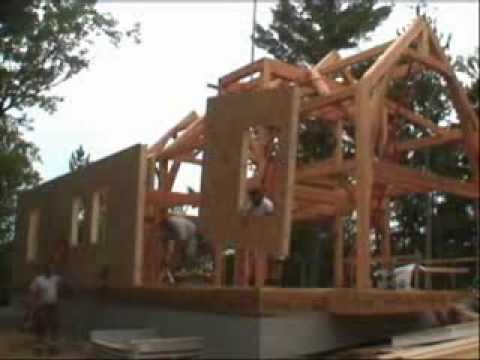 Riverbend Timber Frame Raising, Enclosing the Frame with SIPS - YouTube