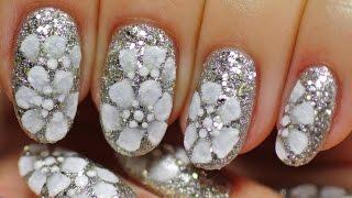 Nail Art. Frosty Flowers. Winter Shiny Design.