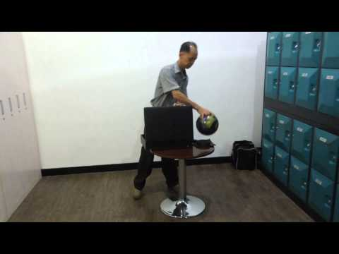 Bowling Ball From Briefcase by Jacky Lee