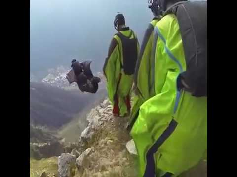 A Group Wing Suit Base Jumping off Cliff